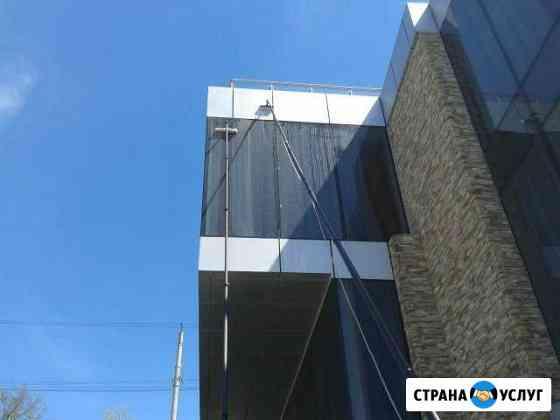 Мойка стеклянных фасадов зданий с земли до25 м Сочи
