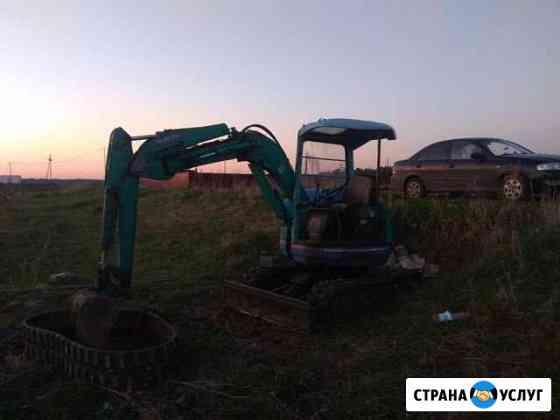 Услуги мини экскаватора глубина копание 2.9м Омск